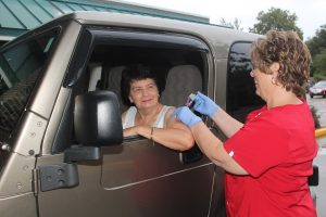 Rain didn't stop 75 people from participating in the Drive-Thru Flu Clinic sponsored by Mahaska Health Partnership Public Health on Saturday, Oct. 7. The entrance #1 awning provided the perfect shelter for those wanted to receive their flu vaccination in the comfort of their cars. Joan K. Wefer of Oskaloosa is shown receiving her flu shot from MHP Public Health Nurse Judi Veldhuizen. Weekly Flu Vaccination Clinics are also being offered at MHP, entrance #4 on Wednesdays from 7 am to 6 pm. Appointments are not needed. In addition, flu vaccines are available by appointment; please call 641.672.3360. (submitted photo)