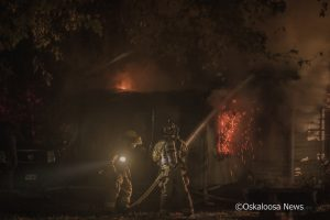 Oskaloosa firefighters battled flames for over 4 hours on Monday morning at a residence located at 307 N C Street in Oskaloosa.