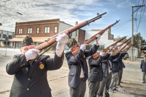 The honor guard performs their 21-gun salute on Saturday after the program at the American Legion. November 11, 2017
