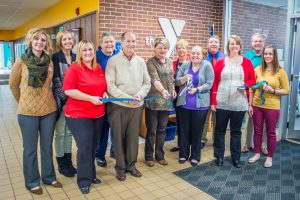 Robbyn Duchow cuts the ribbon officially opening the Big Brothers and Big Sisters of Mahaska County.