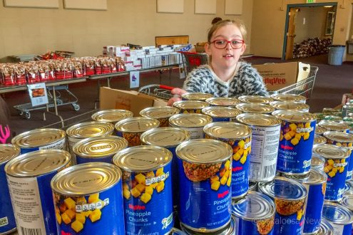 Sunny Netland helped out Friday afternoon filling boxes for the Rotary Food Basket program.