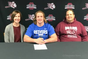 "Oskaloosa's Blake Va signed his letter of intent to play for Iowa Western. The 6' 1"" had 47.5 total tackles on the year, with 4 sacks. (submitted photo)"