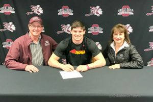 Oskaloosa's Seth Howard signed his letter of intent to play football for Simpson College. Howard had 1270 yards in the air during the 2017 season. (photo submitted)