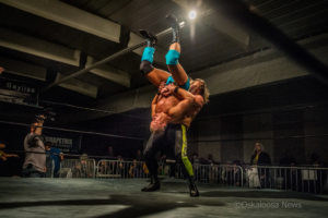 Tony Storm prepares to body slam Rory Fox during their first match. Storm won to claim the CEW Championship Belt.