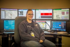 Brandi Greatbatch sits at her workstation for Mahaska County 911 Communications.