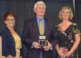 Guy Vander Linden (center) accepts Citizen of the Year award from the OACDG