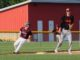 Tyler Miller hits the brakes at 3rd base against Grinnell. (photo by Tasha Janssen)