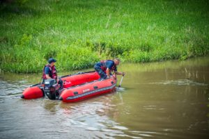 Oskaloosa Firefighters search the banks of the South Skunk River on Saturday afternoon.