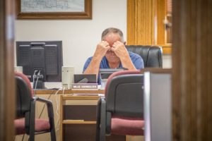 Mahaska County Supervisor Henry Van Weelden sits at his desk moments before leading the meeting that will certify the primary election in Mahaska County. Van Weelden was the lowest vote getting in the Republican primary, and will not be on the ballot in November.