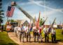 Veterans march into Forest Cemetery on Monday, May 28th, 2018 for Memorial Day.