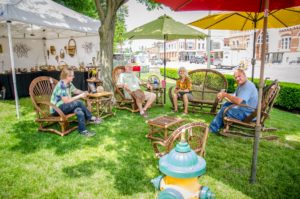 A group of artists and friends enjoys the shade as the 50th Annual Art on the Square comes to an end.