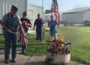 Veterans destroy retired U.S. Flags. (photo by Hailey Brown)