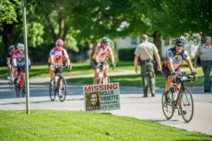 Mollie Tibbits was reported missing from Brooklyn, Iowa on July 19th, 2018. Efforts have been underway since then to locate the missing 20-year-old. RAGBRAI riders pass a sign for Mollie in New Sharon, Iowa.