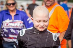 Caleb Hammond smiles during his racing experience on Saturday. (photo by Denis Currier/Oskaloosa News)