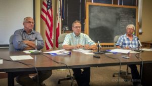 Mahaska County Supervisors Willie Van Weelden, Mark Groenendyk, and Steve Wanders agreed to file suit against Mahaska E911 and Emergency Management boards at their meeting on Tuesday.