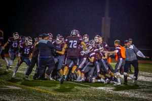 The celebration erupted when Oskaloosa defeated Pella 36-35 on a gutsy 2 point conversion play in overtime. Photo by Denis Currier/Oskaloosa News