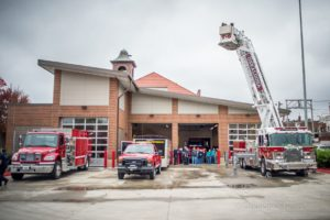 Oskaloosa firefighters demonstrate their new aerial apparatus to visitors to their open house this past week.