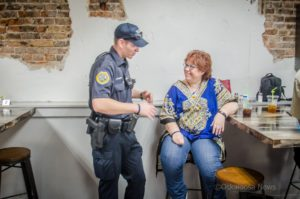 Members of law enforcement and the public had an opportunity to get to know each other outside of an emergency situation. In the case of this picture, the police officer [Riley Calhoun] gets a bit more instruction from mom.