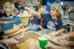 Oskaloosa Christian School students helped to pack 20,000 meals for the Meals from the Heartland program on Friday afternoon.