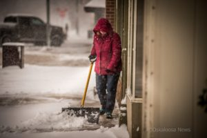 Shoveling off the sidewalks in downtown Oskaloosa on Saturday morning may have felt a bit futile a times, as the snow continued to come down. Area residents measured 8 inches or more of snow from the storm.