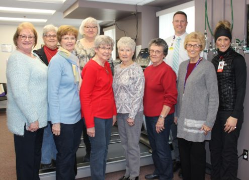 The Mahaska Health Hospital Auxiliary recently donated a new commercial grade rehabilitation treadmill for use in the cardiac rehabilitation portion of Mahaska Health cardiopulmonary services. Pictured with the treadmill from left to right are: Volunteer Coordinator Kim Langfitt; Auxiliary Board Members Carole Comstock, Sharon Palmer, Becke Arnold, Sherill Helm, Janet Masterson and Lorraine Blom; Mahaska Health CEO Kevin DeRonde; Auxiliary Board Member Judy Lewis; and Cardiac Rehab Nurse Renee Edgar
