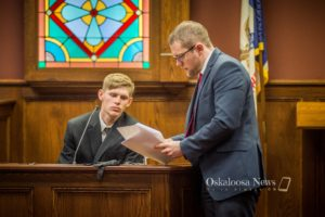Elijah Marcus is seen answering questions for Mahaska County Attorney Andrew Ritland during court on Thursday afternoon.